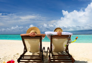 bigstock-Couple-on-a-tropical-beach-at--43406755